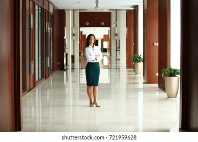 Smiling confident business woman looking at camera at office
