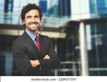 Smiling confident businessman with folded arms