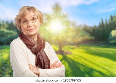 Smiling confident middle aged business woman posing
