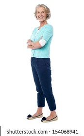 Smiling confident woman posing with arms crossed
