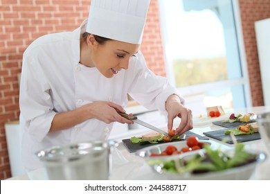 Smiling cook preparing appetizer