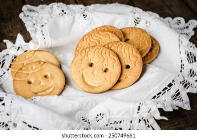 Smiling cookies on white napkin