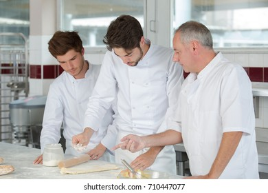 smiling cooks making french chausson
