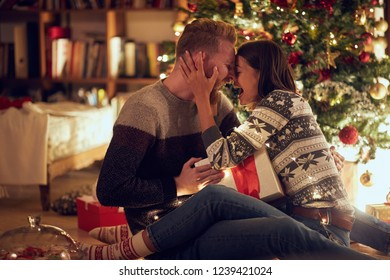 smiling couple celebrating Christmas together