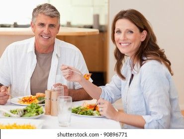 Smiling couple eating dinner together