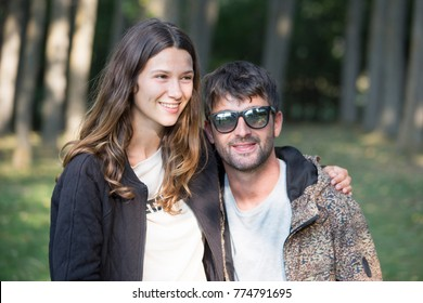 Smiling couple in forest