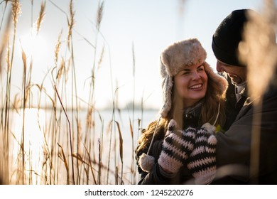 Smiling couple gazing at each other while hugging