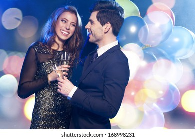 Smiling couple with glasses of champagne