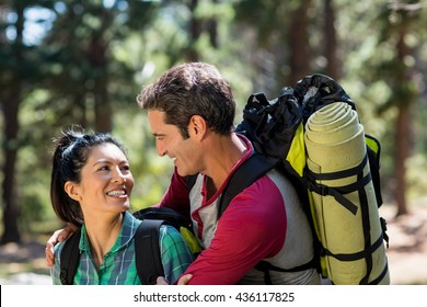 Smiling couple hiking in the forest