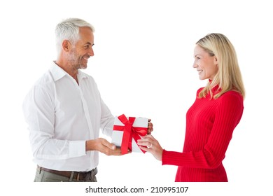 Smiling couple holding a gift on white background