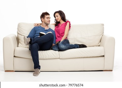 smiling couple looking romantically at each other book