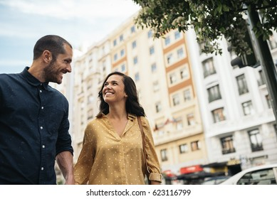 Smiling couple of lovers having fun in the street.