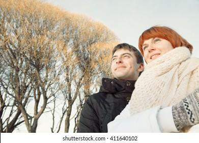 Smiling couple portrait in winter park