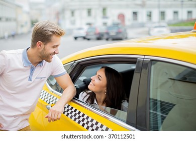 Smiling couple in a taxi