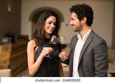 Smiling couple toasting wineglasses