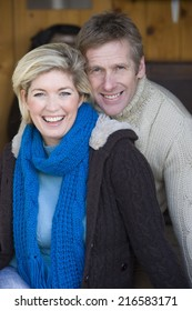 Smiling couple wearing sweaters