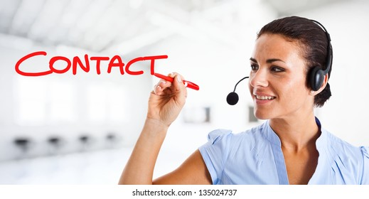 Smiling customer representative writing contact on the screen