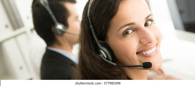 Smiling customer service staff in call center, panoramic banner