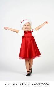 Smiling cute 3 years old girl in studio