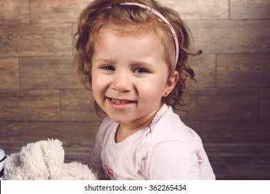smiling cute girl holding toy