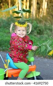 Smiling cute girl on bike
