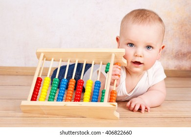 Smiling  cute toddler playing with abacus