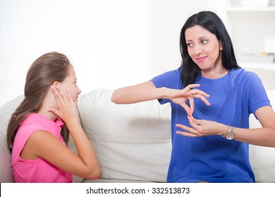 Smiling deaf girl learning sign language