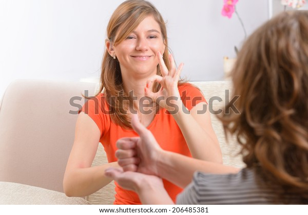 Smiling deaf woman learning sign language