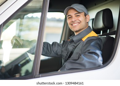 Smiling deliverer driving van