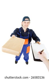 Smiling delivery boy gives a box to you and wants you signature in the clipboard
