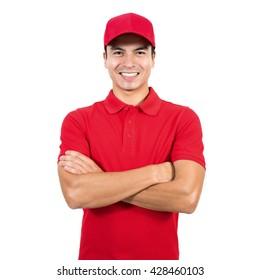 Smiling delivery man in red uniform standing with arm crossed - isolated on white background