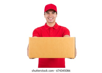 Smiling delivery man in red uniform giving a box, isolated on white background - courier service concept