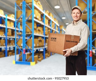 smiling delivery man in warehouse