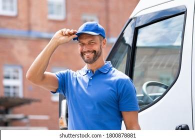 Smiling Delivery Men Or Handyman In Uniform Near Truck