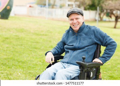 Smiling disabled man in the park. Freedom