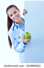 Smiling doctor with apple and blank banner. Woman doctors.