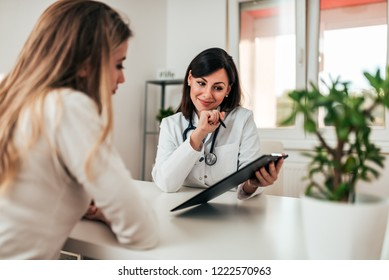 Smiling doctor consulting her patient.