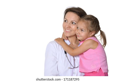 Smiling doctor holding a happy baby on her hands