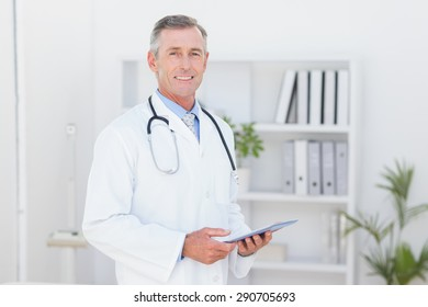 Smiling doctor looking at camera in medical office