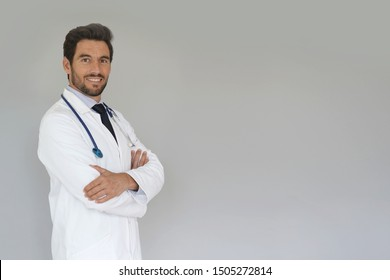 Smiling doctor standing on grey background