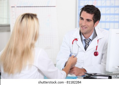 Smiling doctor taking patient's card