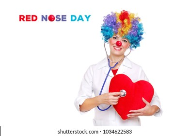 smiling doctor wearing clown accessories presenting red nose day