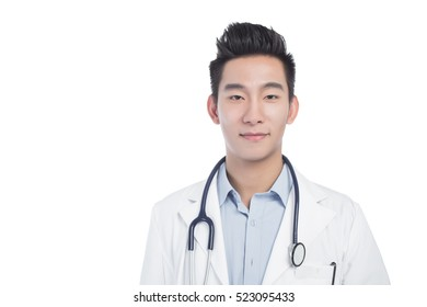 Smiling doctor working with clipboard