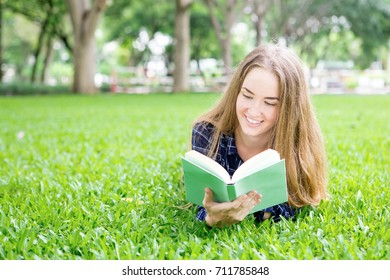 Smiling dreamy girl reading romance book