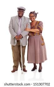 smiling elderly africam couple standing on white background