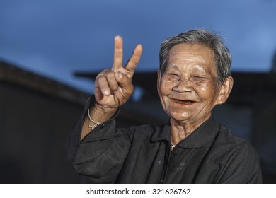 Smiling elderly people on countryside home background in thailand