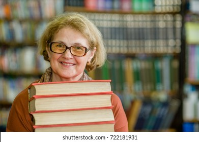 smiling elderly woman with books in library. Space for text