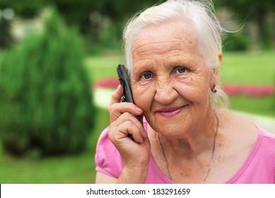 Smiling elderly woman senior portrait on the phone