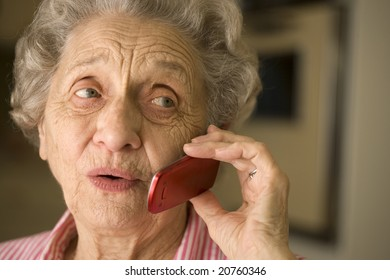 Smiling elderly woman talking on cell phone