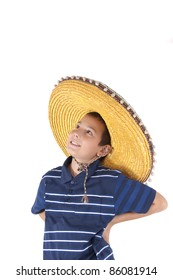 The smiling eleven-year teenager in a sombrero looks upwards